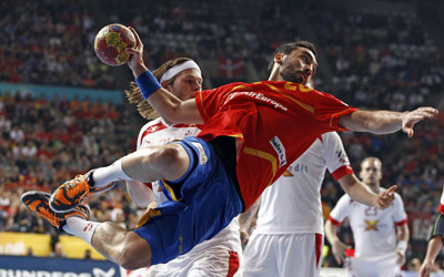 Spain's Garcia attempts to score in front of Denmark's Hansen during their Men's Handball World Championship final match in Barcelona