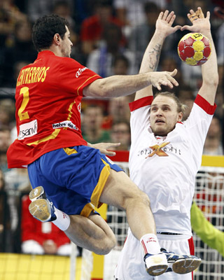 Denmark's Jensen blocks a shot of Spain's Entrerrios during their Men's Handball World Championship final match in Barcelona
