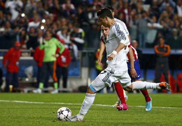 Real Madrid's Ronaldo scores a penalty against Atletico Madrid during their Champions League final soccer match at the Luz Stadium in Lisbon